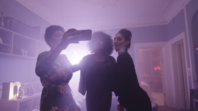young women dancing at party with camera - back lit stock videos & royalty-free footage