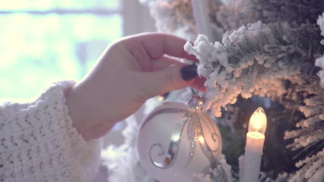 young women decorating the christmas tree - hanging stock videos & royalty-free footage