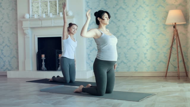 young women doing yoga meditation and stretching exercises - full hd format stock videos and b-roll footage