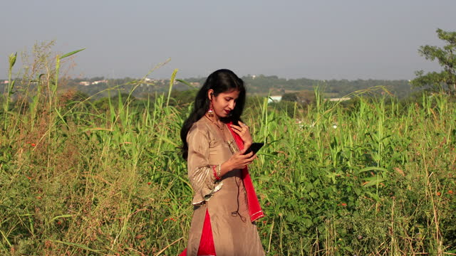 young women enjoying the music by using mobile phone - sorghum stock videos & royalty-free footage