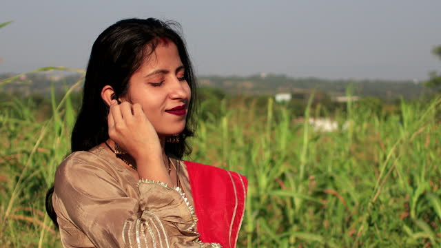 young women enjoying the music outdoors in the nature - sorghum stock videos & royalty-free footage
