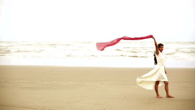 young women flying scarf on tropical sandy beach - scarf stock videos & royalty-free footage