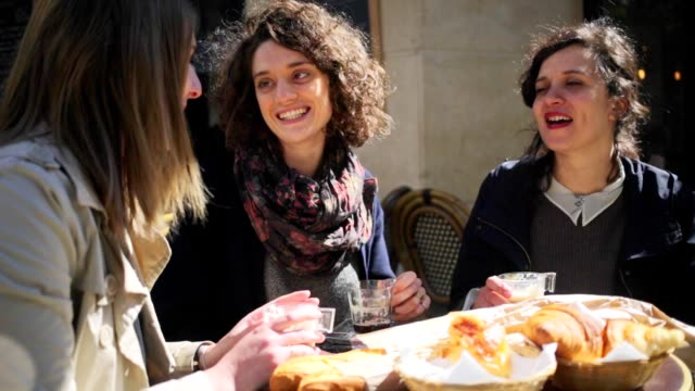 young women friends meeting at a paris cafe - france stock videos & royalty-free footage