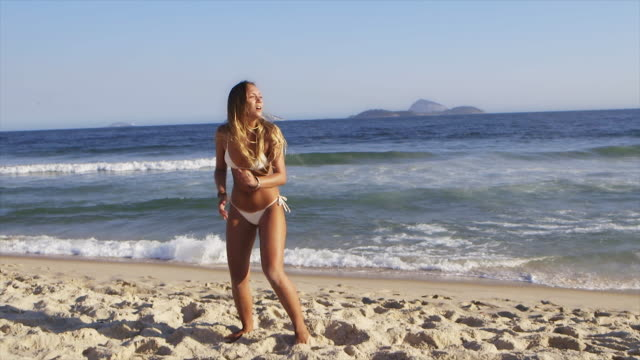 MS Young women in bikinis play football (altinho) on Ipanema Beach / Rio de Janeiro, Brazil