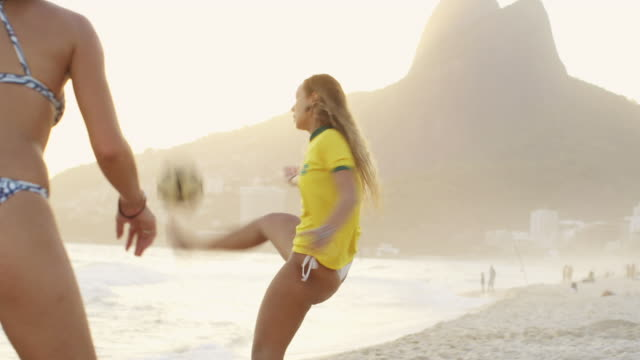 ms young women in bikinis play football (altinho) on ipanema beach / rio de janeiro, brazil - only young women stock videos and b-roll footage