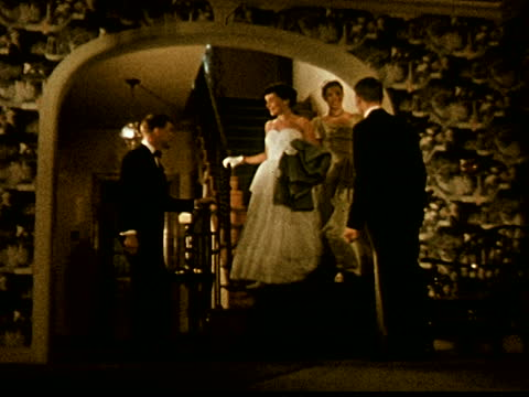 young women in formal dress greet two young men at bottom of stairs - dinner jacket stock videos & royalty-free footage