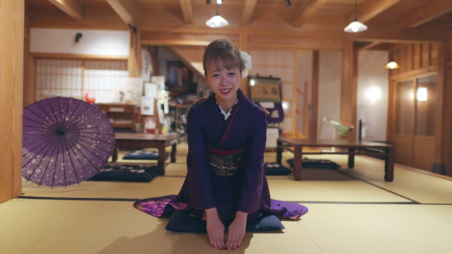 young women in 'furisode' kimono sitting on heels and bowing in japanese 'tatami' room - japanese culture stock videos & royalty-free footage