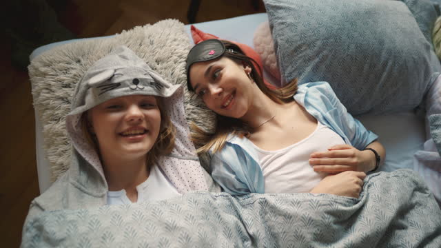 young women in nightwear lying in the bed and resting - nightwear stock videos & royalty-free footage
