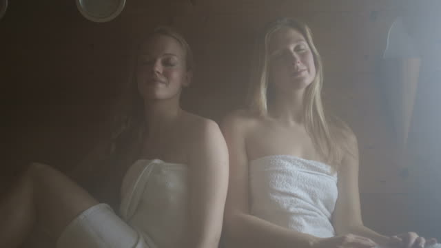 stockvideo's en b-roll-footage met young women in sauna - sauna