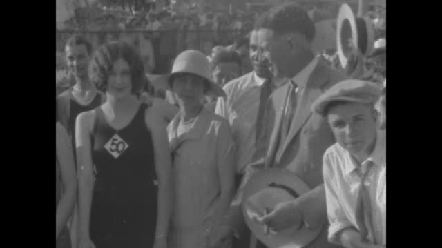 vídeos y material grabado en eventos de stock de ms young women in swimsuits shake hands with man in suit during beauty contest / note exact month/day not known film has nitrate deterioration - oklahoma