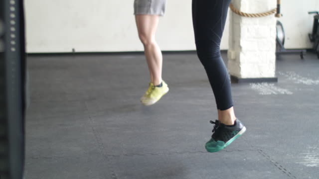 young women jumping rope at the gym - jump rope stock videos & royalty-free footage