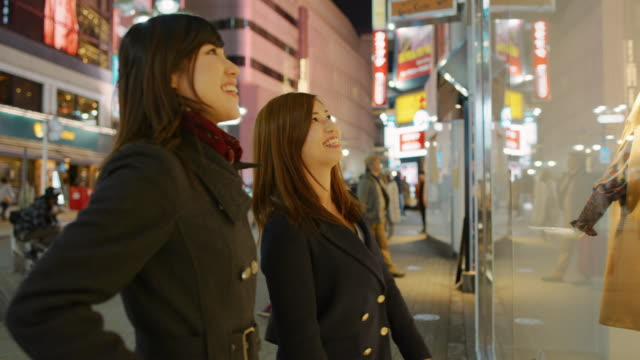 ms young women look at a shop window / tokyo, japan - window display stock videos and b-roll footage