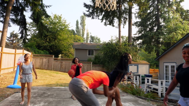 ms young women playing basketball in backyard on summer afternoon - pacific islander girl stock videos & royalty-free footage