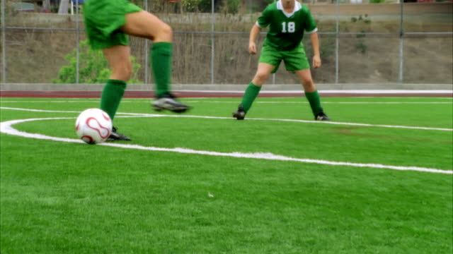 slo mo, cu, young women playing soccer, low section, biola university, la mirada, california, usa  - amateur stock-videos und b-roll-filmmaterial