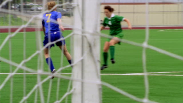 slo mo, ms, pan, young women playing soccer, view through goal post net, biola university, la mirada, california, usa  - zahl 7 stock-videos und b-roll-filmmaterial