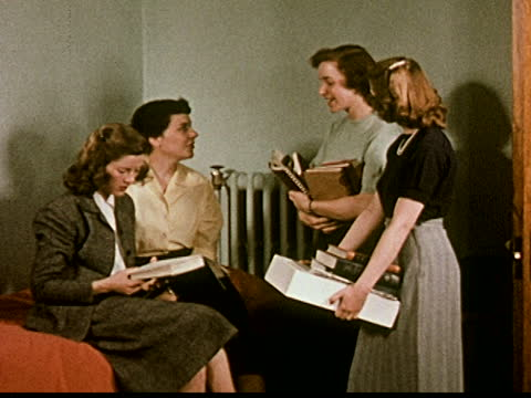 young women reading together in bed, four students talking about studying chemistry. - home economics class stock videos & royalty-free footage