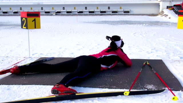 hd: young women shooting at biathlon competition - biathlon stock videos and b-roll footage