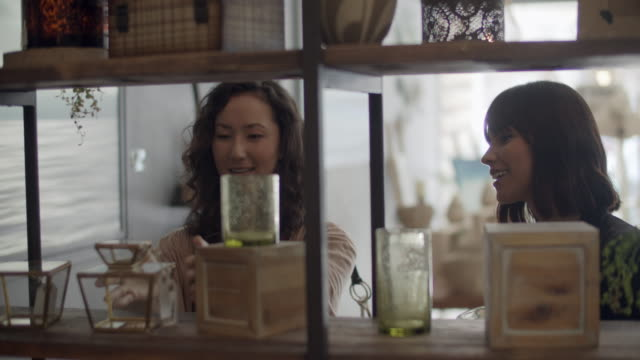 cu young women shopping together in a sustainable store. - customer点の映像素材/bロール