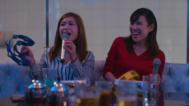 WS Young women sing karaoke / Tokyo, Japan