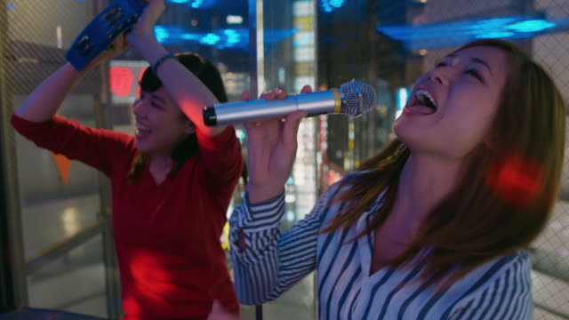 MS Young women sing karaoke / Tokyo, Japan