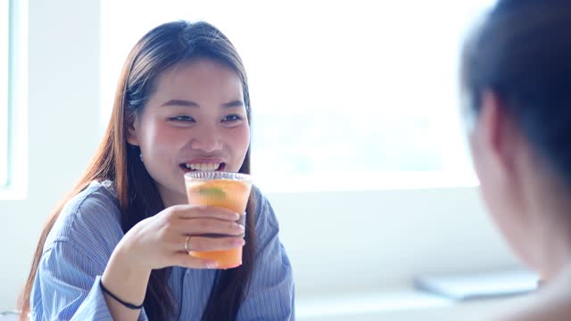 young women sitting down drinking juice - happy hour stock videos & royalty-free footage