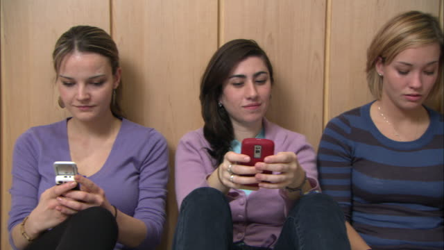 ms ds side pov young women sitting side by side and texting, brooklyn, new york city, usa - side by side stock videos & royalty-free footage