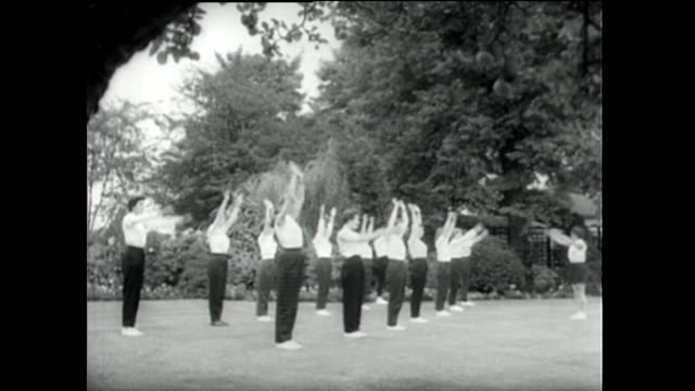 young women take part in exercise classes at finishing school; 1955 - 1955 stock videos & royalty-free footage