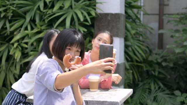 young women taking selfie picture in school yard - weekend activities stock videos & royalty-free footage