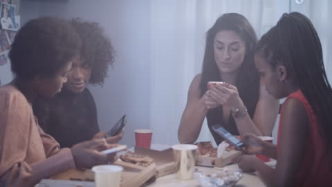 young women talking and looking at smart phones - fast food stock videos & royalty-free footage