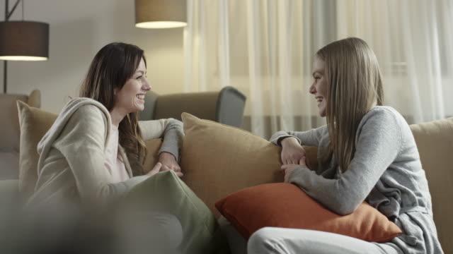Young women talking on sofa
