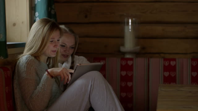 young women using digital tablet in chalet - only young women stock videos & royalty-free footage