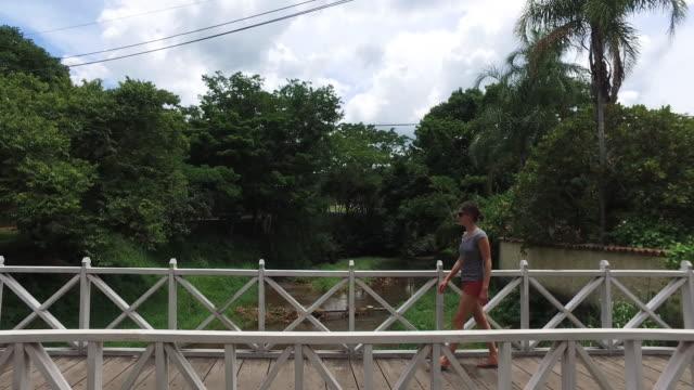 young women walking in goias city, brazil - fluss red river stock-videos und b-roll-filmmaterial