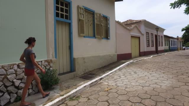 young women walking in goias city, brazil - america del sud video stock e b–roll