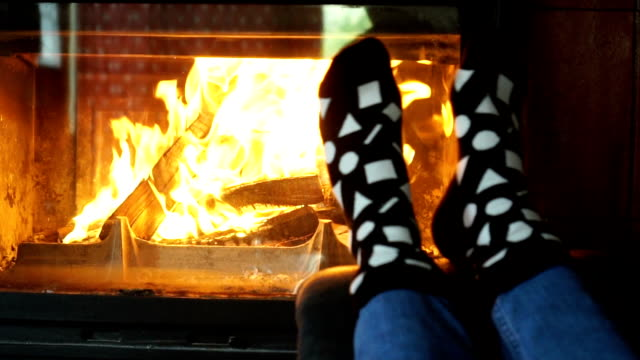 young women warming her feet near fireplace - sock stock videos & royalty-free footage