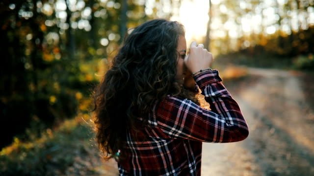 young women with curly hair walking through forest - simple living stock videos & royalty-free footage