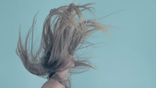 young women with flying hair - persona attraente video stock e b–roll