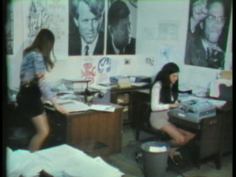 young women work at the democratic national committee office in washington, dc, where posters of democratic icons line the walls. - young adult stock videos & royalty-free footage