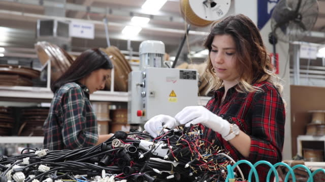 young women working on the production line in factory - middle east stock videos & royalty-free footage