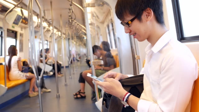 youngman using smart phone on a train - on the move stock videos & royalty-free footage