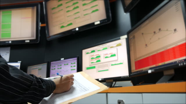 youngnetwork engineer  checking on system control room monitoring - control room stock videos & royalty-free footage