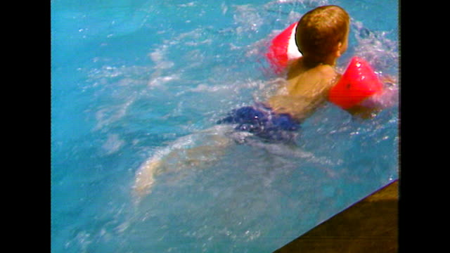 youngs boys learn to swim at summer camp; 1984 - swimming stock videos & royalty-free footage