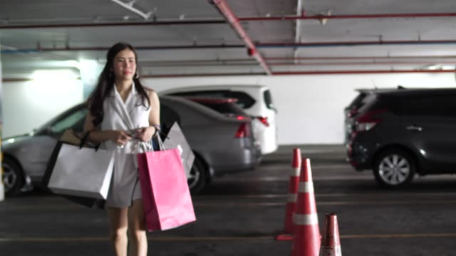 youngwoman finish shopping and back to the car - voice stock videos & royalty-free footage
