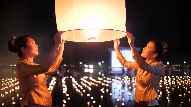 youngwoman praying and release lantern in loi krathong festival - hope concept stock videos & royalty-free footage