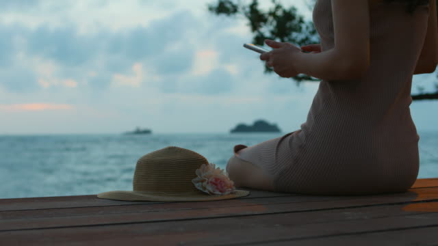 youngwoman relax at the ocean deck - hands behind head stock videos and b-roll footage