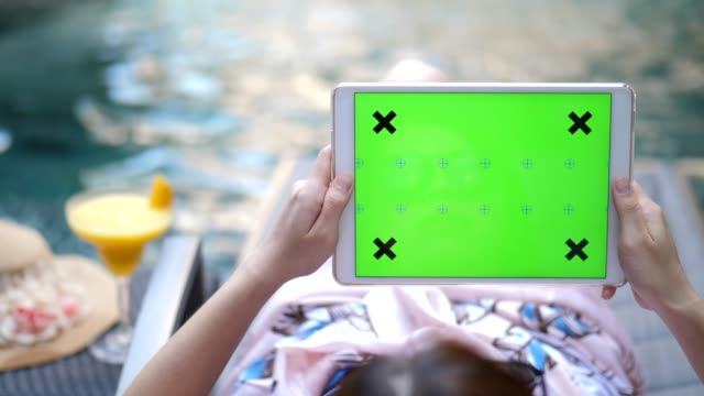 youngwoman relaxing digital tablet on the pool, chroma key-horizontal - portability stock-videos und b-roll-filmmaterial