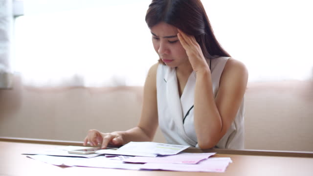 youngwoman stressful moments on bill payment - physical pressure stock videos & royalty-free footage