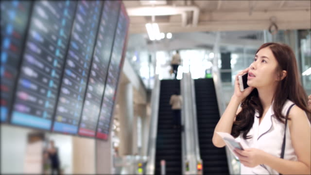 Youngwoman talking at departure board