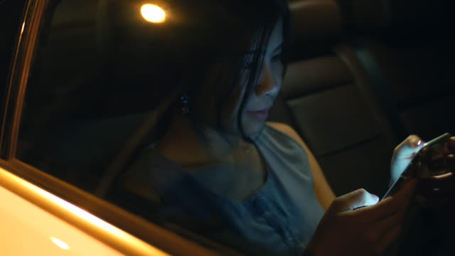 Youngwoman using phone in the Cars