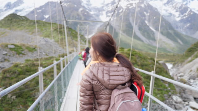 youngwoman walking on hanging bridge - hanging stock videos & royalty-free footage