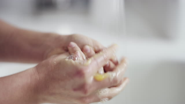 your hands should be close friends with water and soap - soap sud stock videos & royalty-free footage